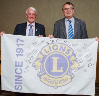 Disatrict Governor David Taylor and 1st Vice District Governor Peter Burnett hold the 105D banner which will be signed by every Lions Club in this District before being paraded with over 700 Banners at the International Convention in Chicago next year.