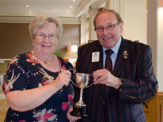 Jenny Bithell of Hythe and Waterside Lions Club is presented with the Best Zone Chairman Award by Immediate Past District Governor Alan Chapman