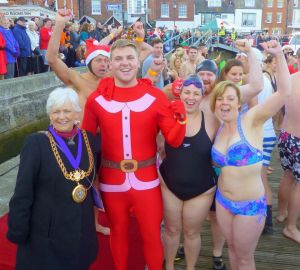 Mayor with group of swimmers