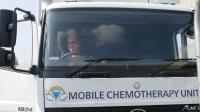 Lion Christine Munday at the wheel of a mobile Chemotherapy unit