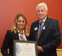 DG David presents his certificate of appreciation to Stephanie Hellier Woods