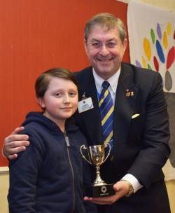 Ned Woodley is presented with the Trophy as District winner of the Peace Poster Competion by Past International Director Phil Nathan