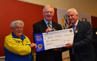 DG David Taylor presents Laurie McMenenemy with a donation to the special Olympics